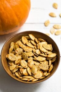 This recipe for savory roasted pumpkin seeds makes a healthy, frugal, vegan snack. Pumpkin seeds are easy to roast in the oven, so don't throw them away! Recipe from realfoodrealdeals.com
