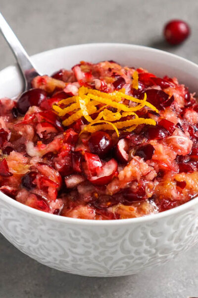 Raw cranberry relish with oranges in a bowl