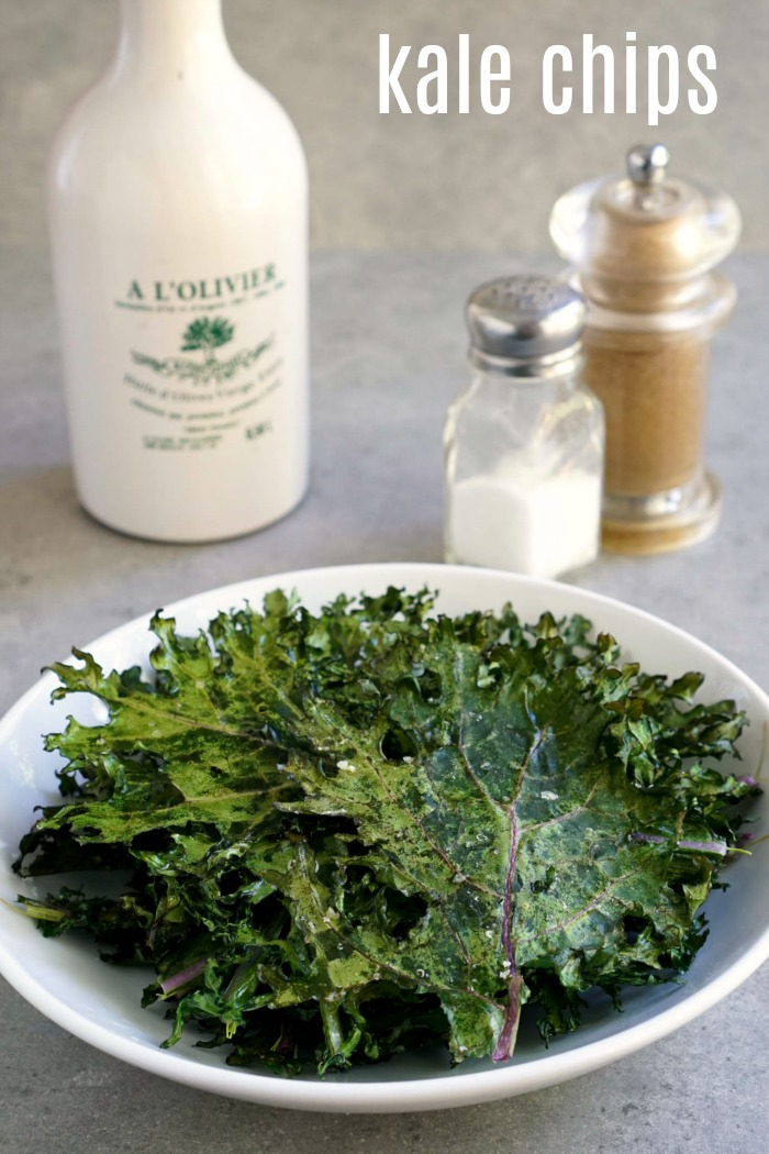 These roasted kale chips are so delicious! Learn how to bake kale chips in the oven with just 3 ingredients for a healthy snack or side dish.