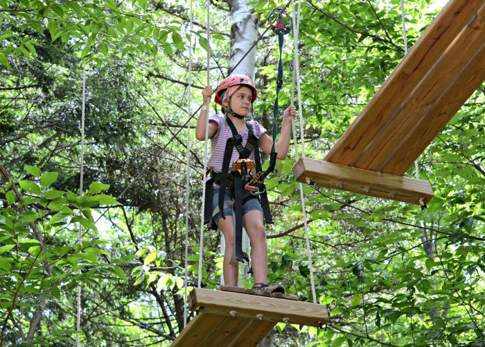 The Treetop Obstacle Course is one of the many fun family activities at Smugglers' Notch Resort in Vermont. My kids were more courageous than me on this one!