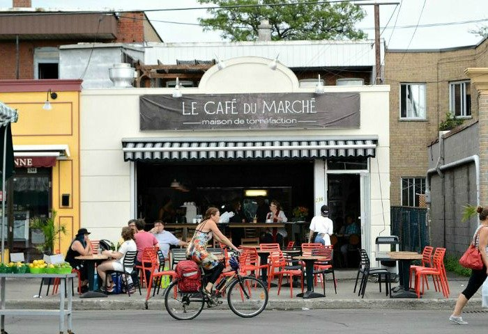 Shops and cafes line the periphery of Jean-Talon Market in Montreal.