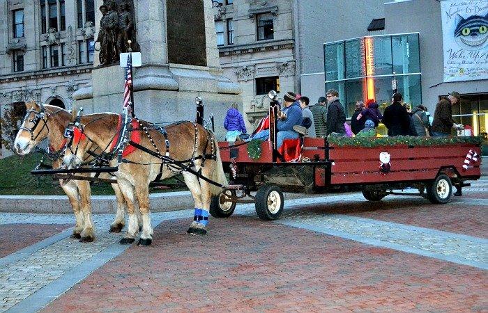 Horse and carriage rides are a free holiday activity to enjoy during December in Portland, Maine.