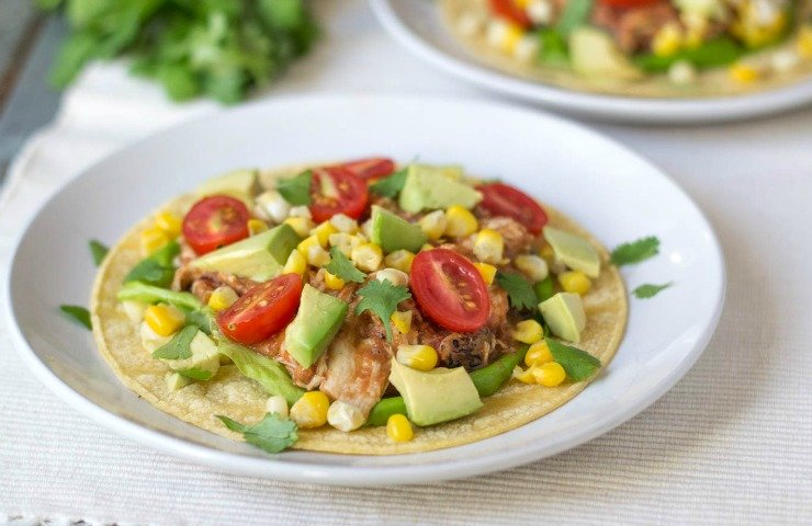 Refried beans taste great in these slow cooker tacos.