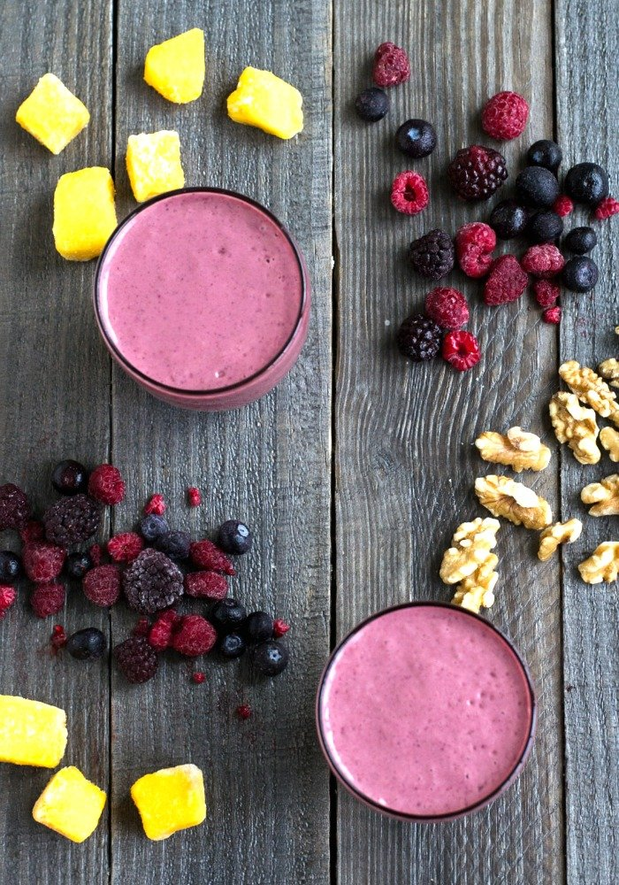 This mango berry smoothie recipe is SO good, and healthy too! It's ready in just 5 minutes. gluten free, dairy free, refined sugar free, vegan