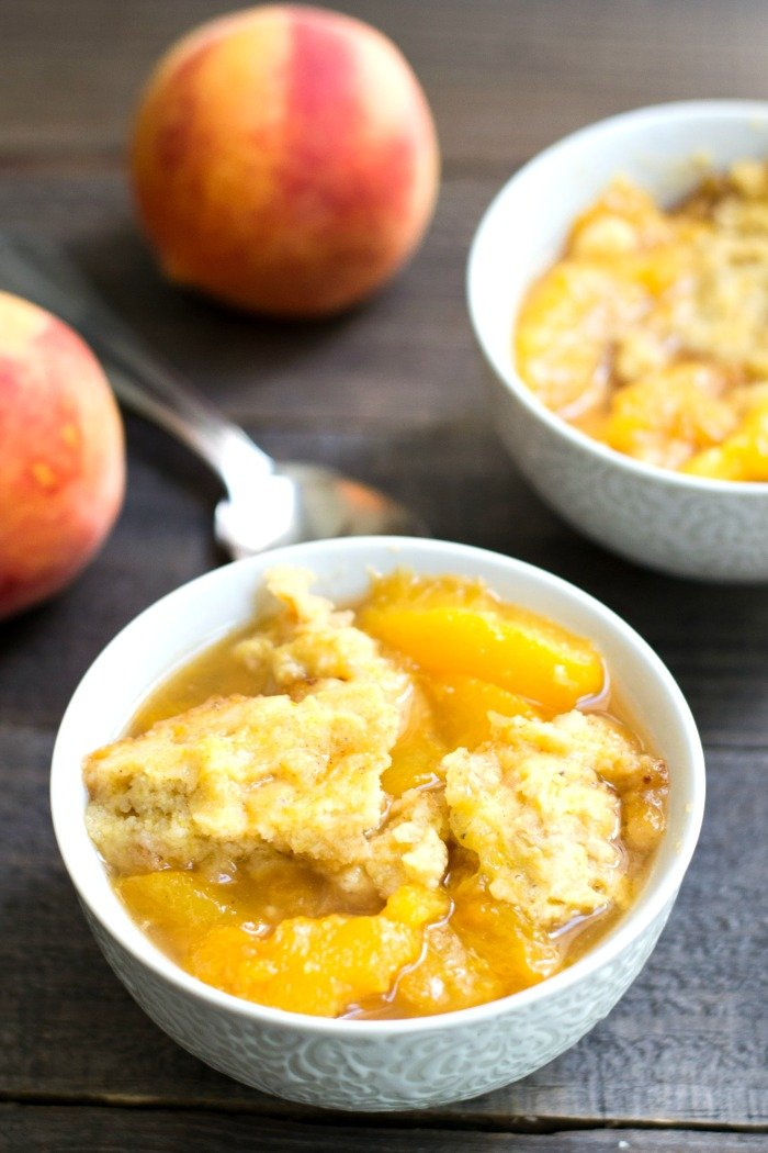 This Crock Pot Peach Cobbler is a healthy, easy dessert recipe for a warm summer day. No need to turn on the oven with this delicious recipe! Gluten-free, dairy-free