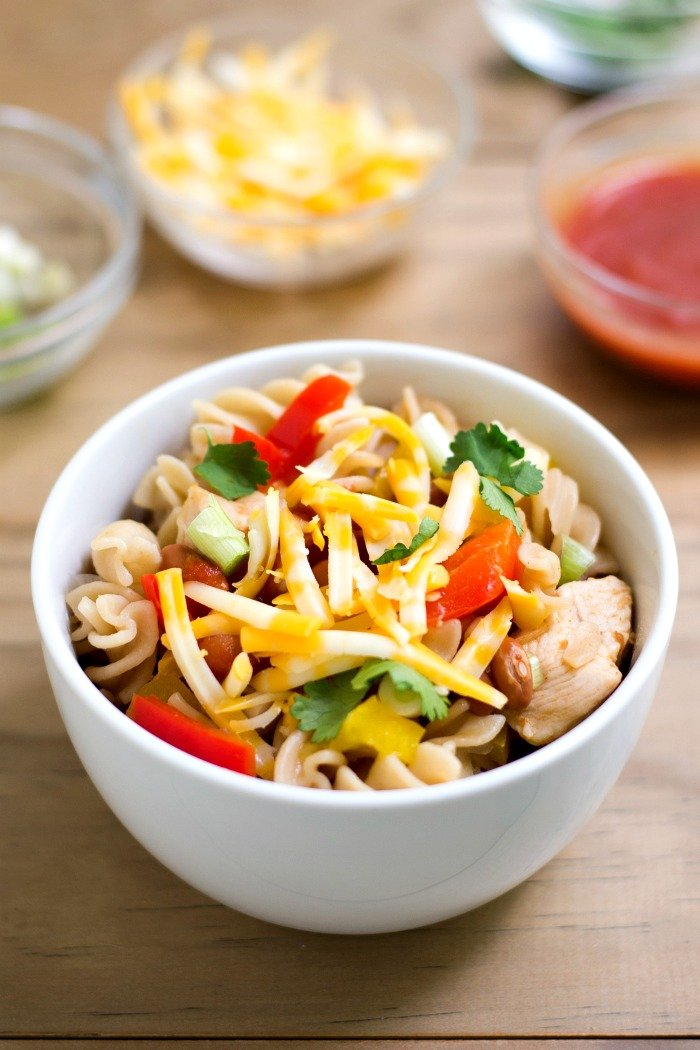 This one pot chicken taco pasta is a delicious, healthy dinner recipe that couldn't be easier to make! Everything cooks in one pot for a quick dinner on a busy night. Recipe from realfoodrealdeals.com