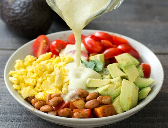 This avocado breakfast burrito bowl is a delicious, healthy recipe. Just look at that creamy avocado dressing! Recipe from realfoodrealdeals.com