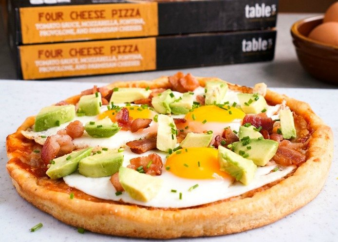 Bacon egg avocado pizza appetizer from Table5 pizza