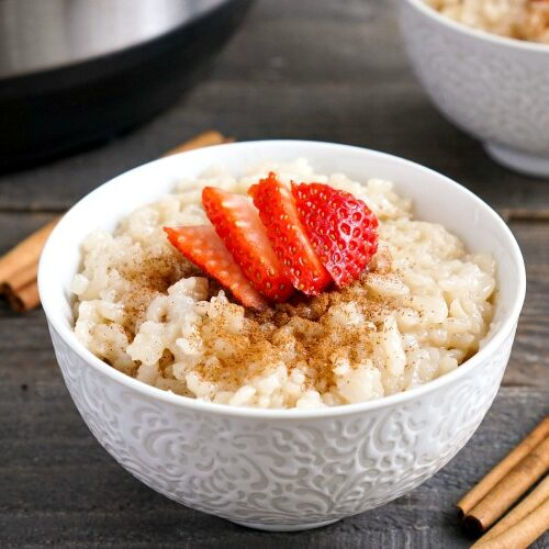 Instant Pot rice pudding served with strawberries and cinnamon