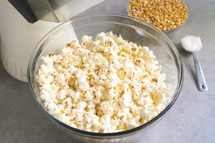 Popcorn with coconut oil is a delicious, frugal vegan snack recipe.
