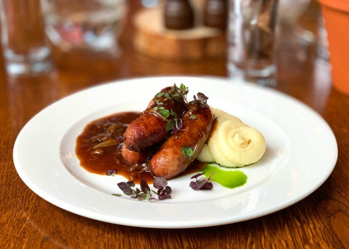 Bangers and mash, the classic meat and potatoes dish, is one of the most famous foods in England.