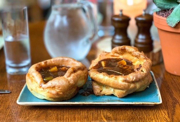 Yorkshire pudding is a classic British popover served with meat and vegetables.