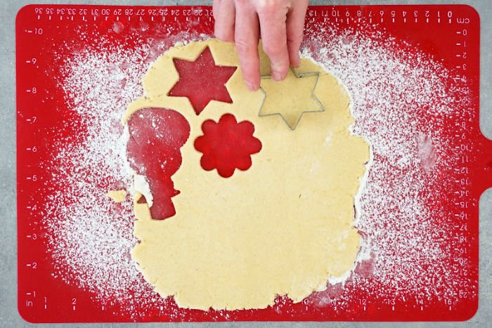 Three inch cookies cutters are used to make these gluten free sugar cookies.