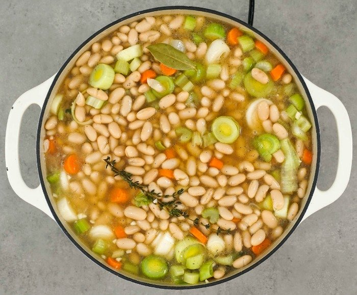 The beans and vegetables simmer in this delicious vegetarian cassoulet.