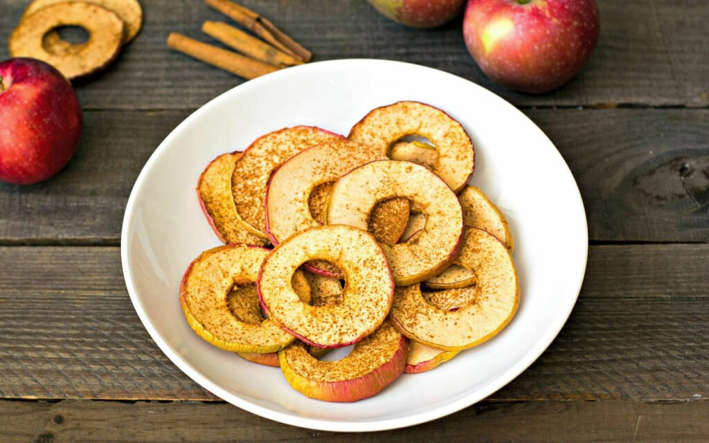Dehydrated apple chips on a plate