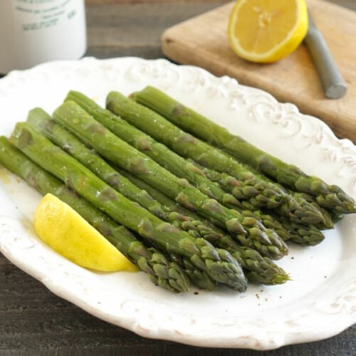 Instant Pot asparagus on a platter with lemon