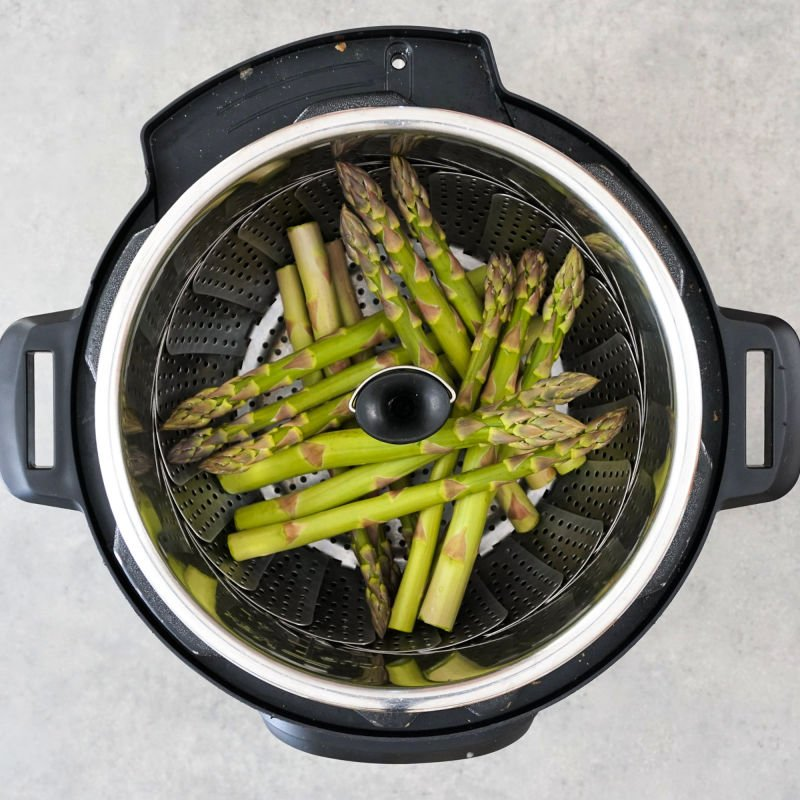 Asparagus in a steamer basket in the Instant Pot