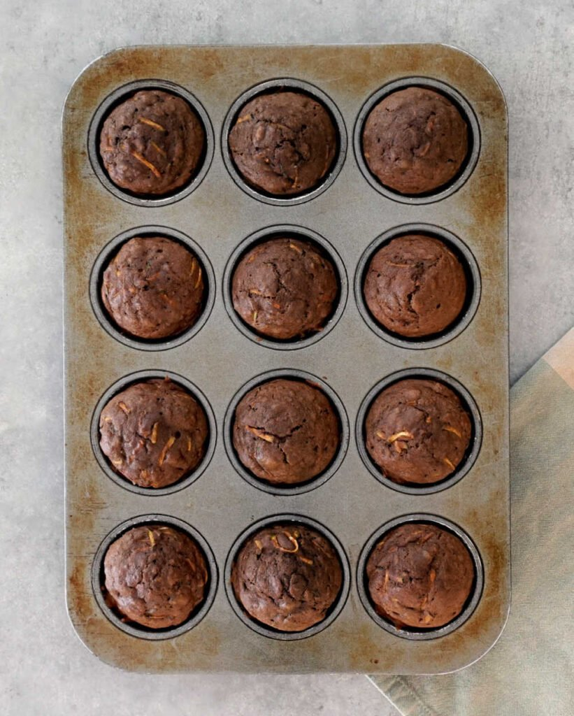 Chocolate zucchini muffins in the pan
