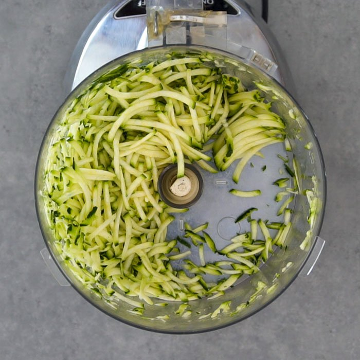 Shredded zucchini in a food processor