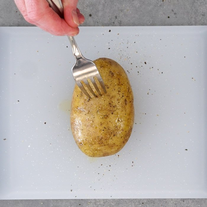 Pierce potatoes with a fork
