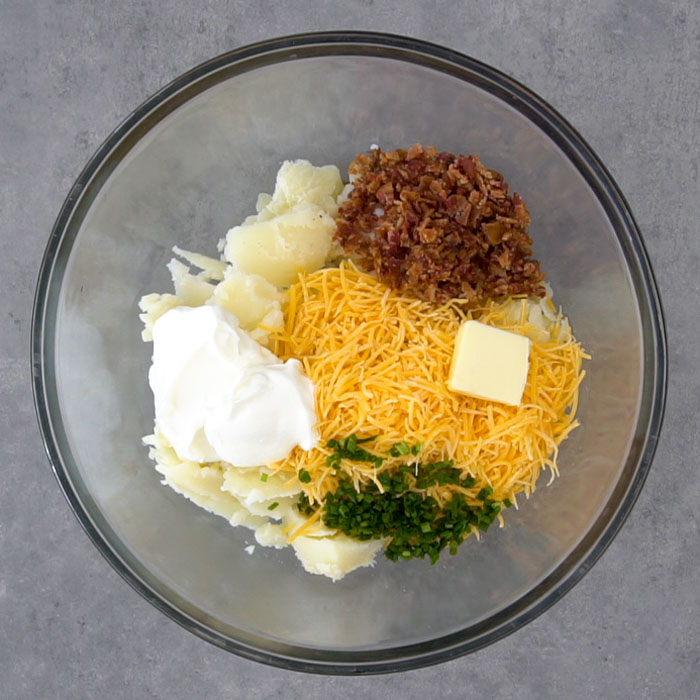 Filling ingredients in a mixing bowl