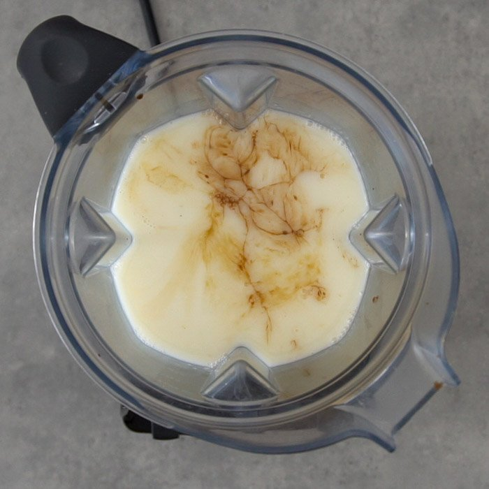 Blender with chocolate oat milk ingredients