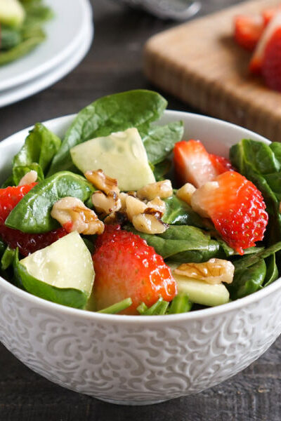 Spinach strawberry walnut salad in a bowl